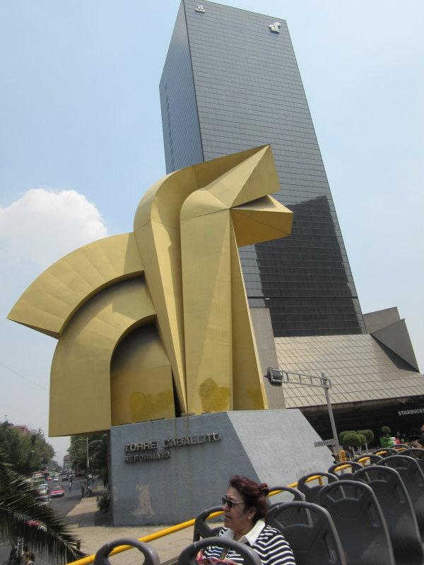 Sculptures everywhere - El Cabalito - a yellow horse