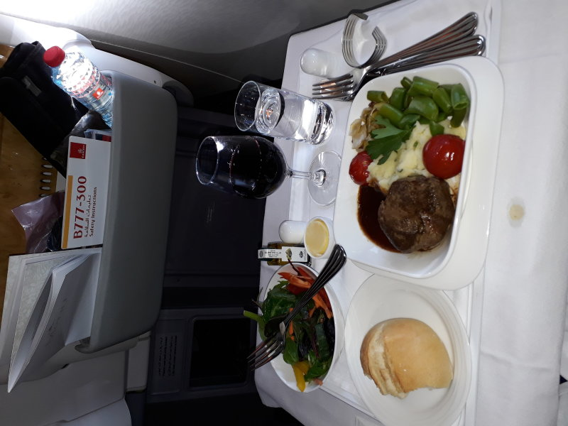 Main course and red vine. B777 Oslo-Dubai