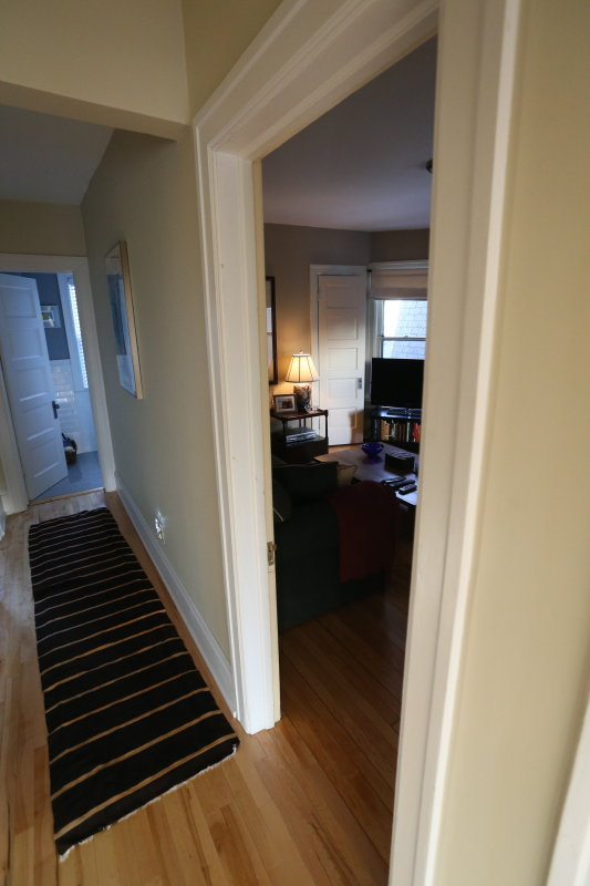 2nd floor hallway from main bedroom to small bedroom bath at end of hall