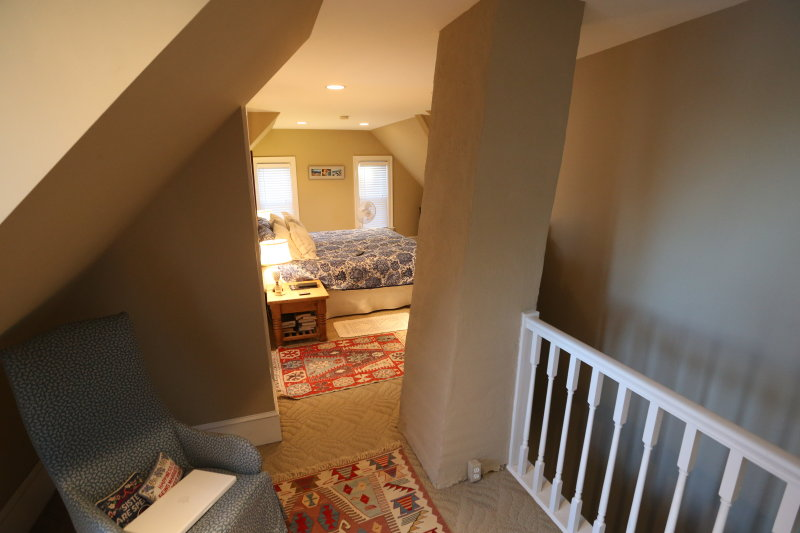 third floor master suite looking into main room from top of stairs