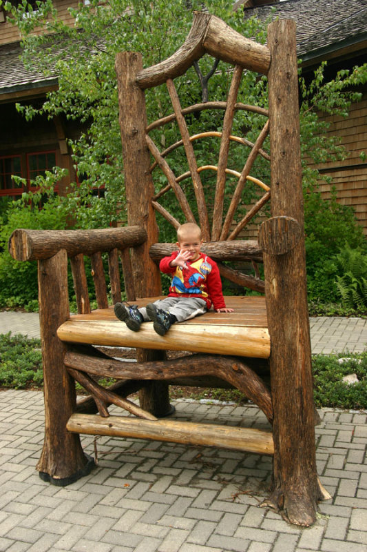 Giant rustic chair at the entrance to the Adirondack museum.
