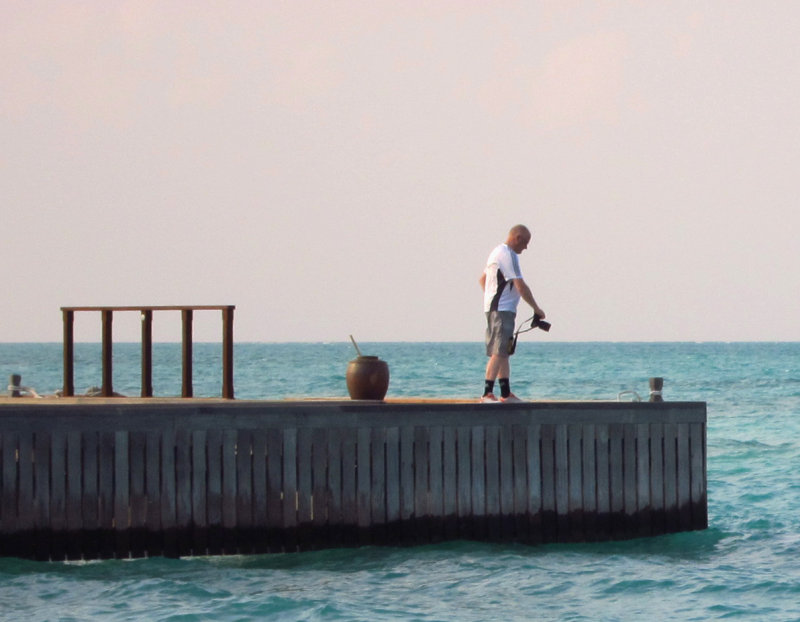 Photographer on the Dhoni dock