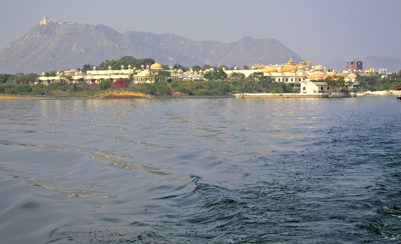 21 Oberoi Udaivillas hotel.  Our room is next to the leftmost big dome, with the Monsoon Palace as backdrop.JPG