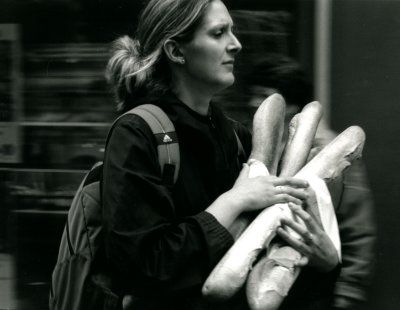 French Woman Carrying Bread, France 2005