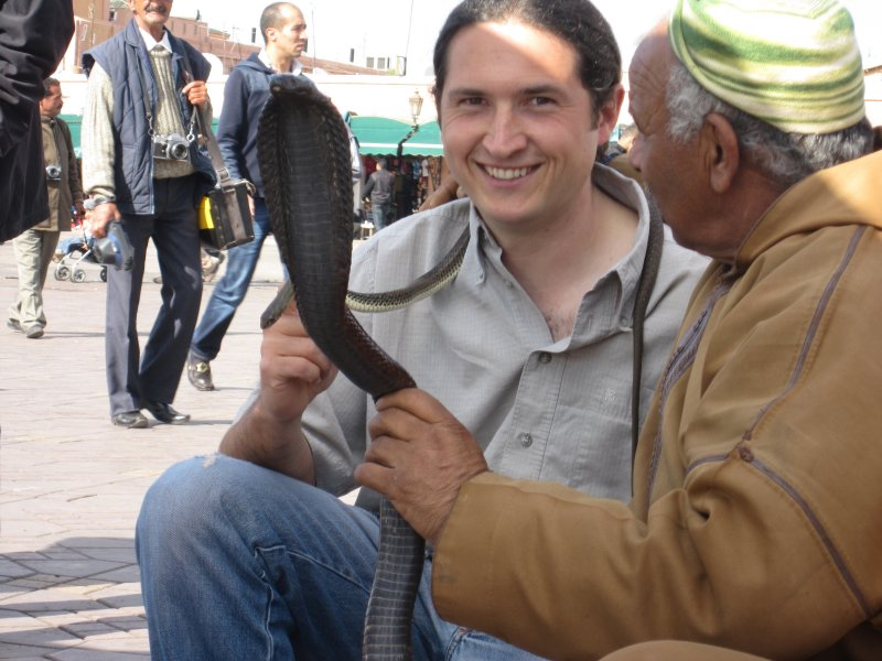Cristian with a black cobra in the Square of Marraqueix