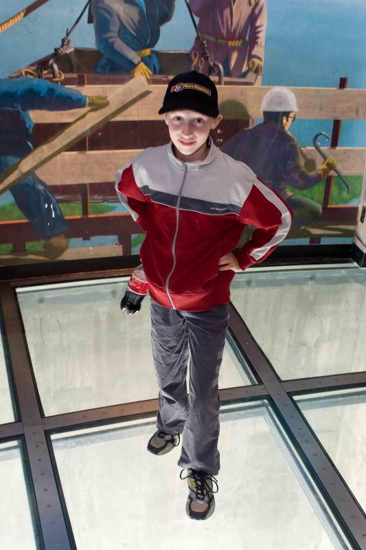 Grant on Glass Floor
