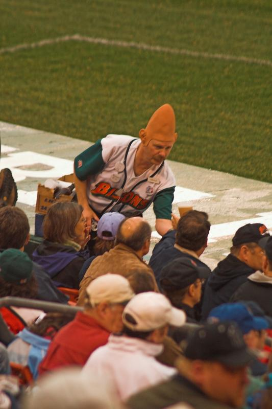 A conehead selling beer