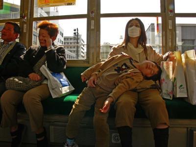 Streetcar riders, Hiroshima, Japan, 2006