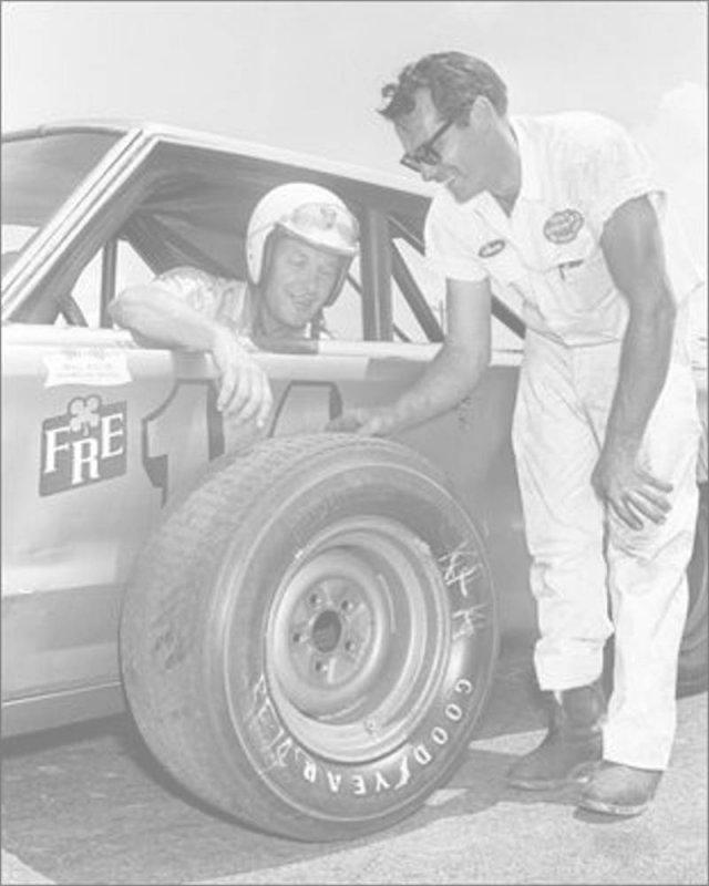 Driver Jim Paschal checks out his tire