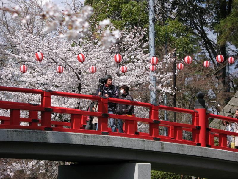 Tripod-wielding photographer on the bridge