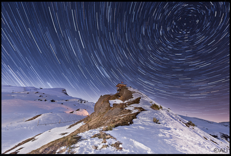star trails over alps
