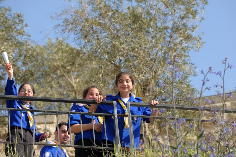 Young girls enjoying a short rest during the procession