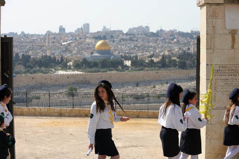 Girls at Palm Sunday procession, with Dome of the Rock in the background