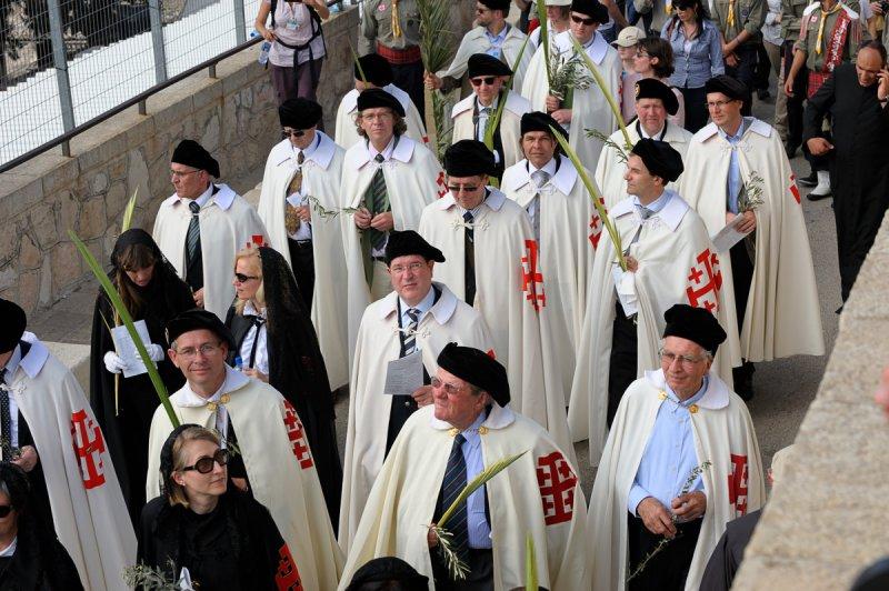 Men wearing robes bearing the Jerusalem Cross, also known as Crusaders Cross