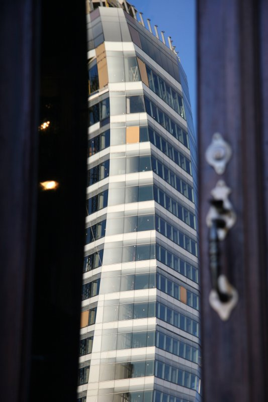 Cooper Square Hotel Tower Reflected in a Residents Front Door Window