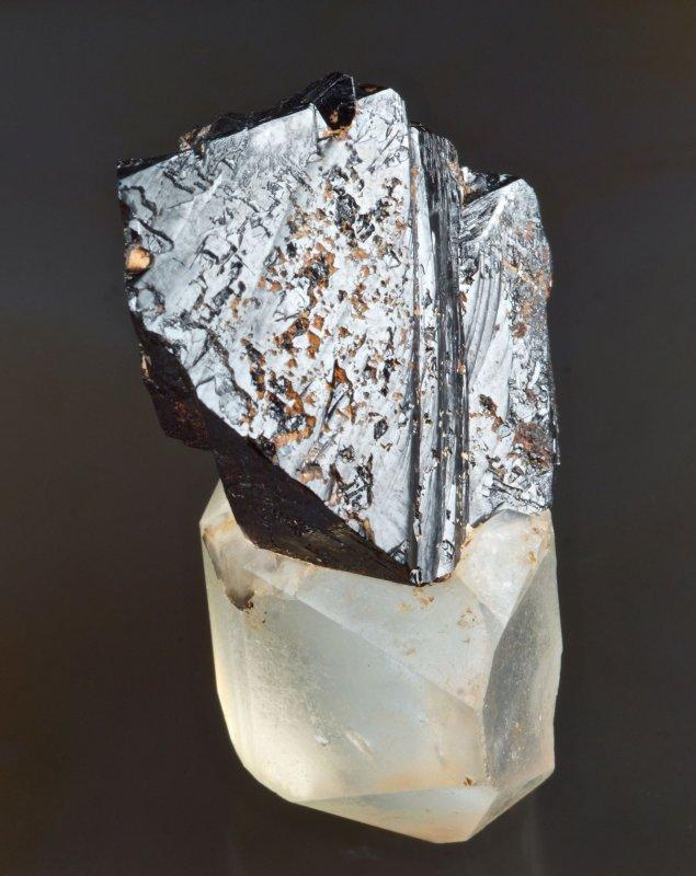 Cassiterite, glossy sharp 32 mm crystal group on a doubly terminated 3 cm quartz crystal. Sakangyi area, west of Mogok, Burma.