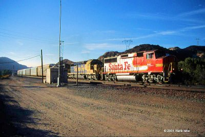 BNSF Red/Silver Warbonnet Heads Through Cajon XOs