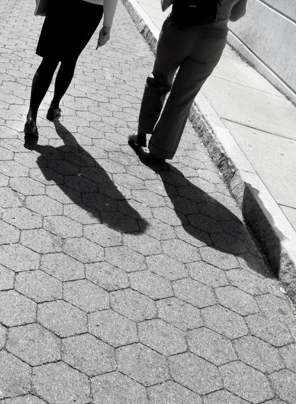 Two shadowed walkers