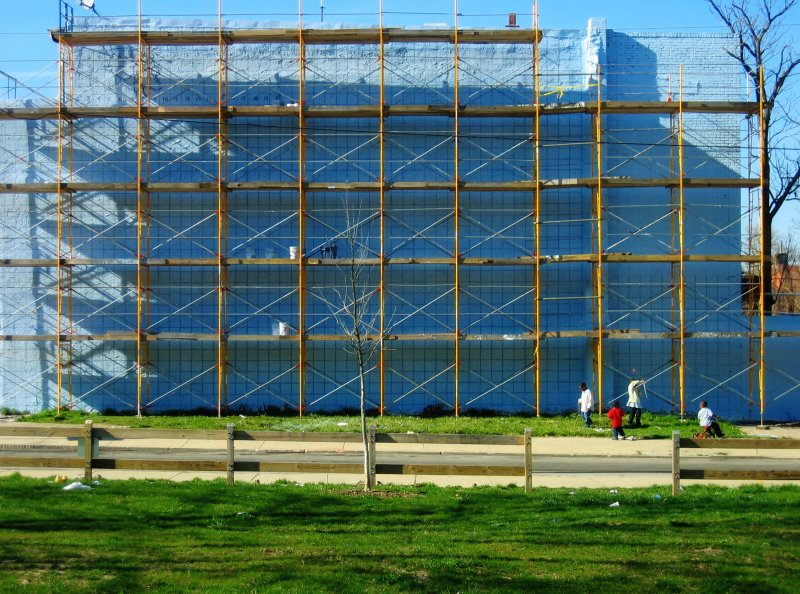Scaffold for a mural, with its shadow