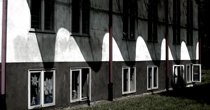 Curved shadows on a square school<br>5673