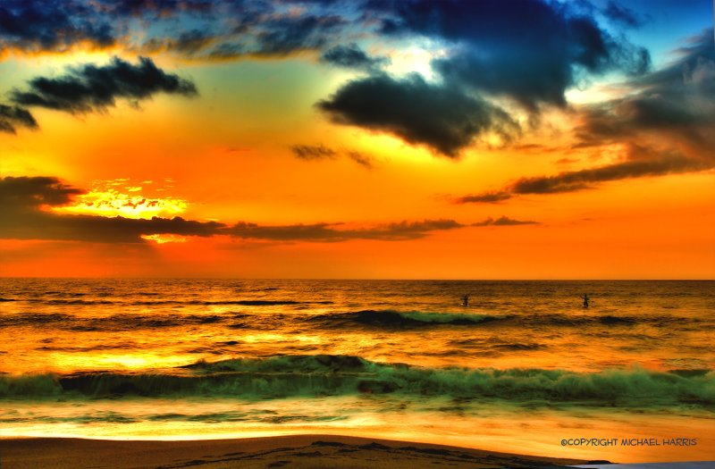 Paddle Surfing at Sunrise