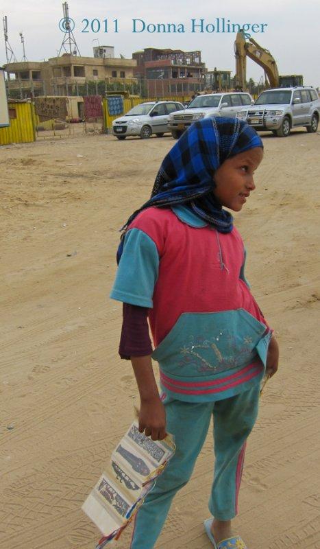 Child Vendor in the Bus Parking Lot
