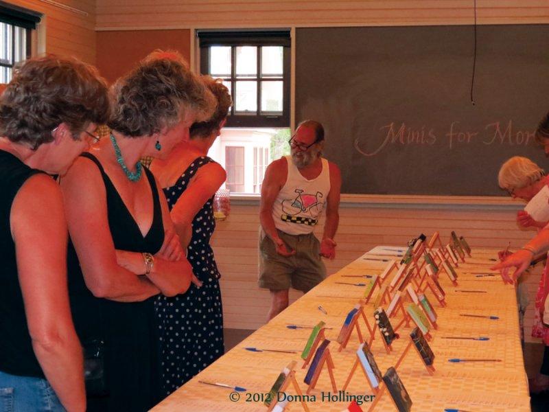 Anita, Steve, et al  looking over the Minis
