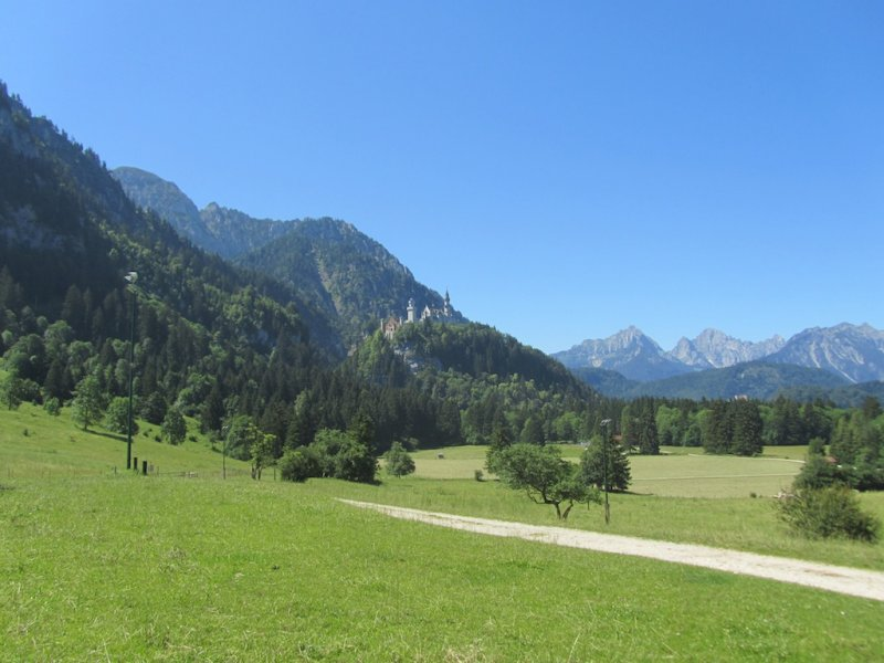 Neuschwanstein and its gatehouse seen from up the valley