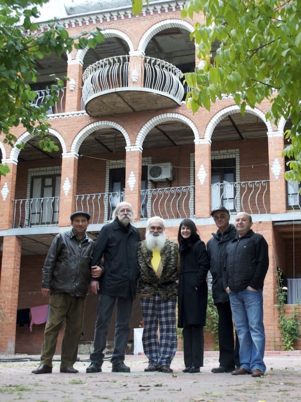 then Mr. Wexler introduces us to the head of the Romani community, at his home