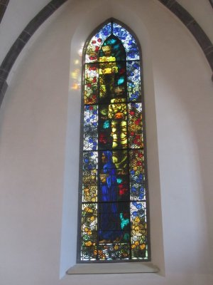 the church has stained glass by Augusto Giacometti