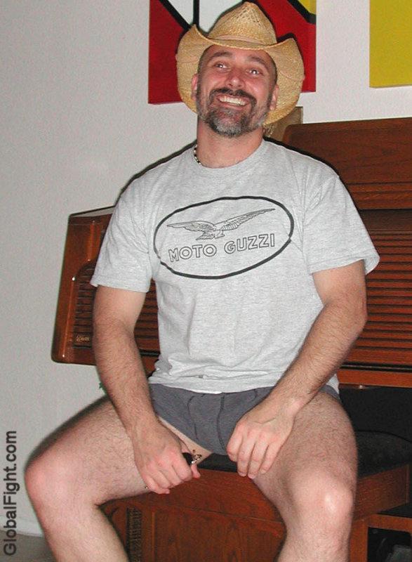 urban gay cowboy straw hat rancher resting.jpg