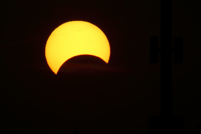 Partial Solar Eclipsed Sun Setting in the West