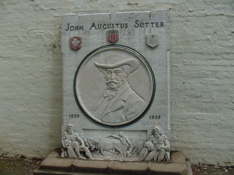This plaque contains a likeness of John Augustus Sutter & honors the centeniall of the founding of the fort.