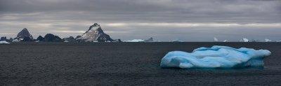 Blue iceberg in antarctic waters