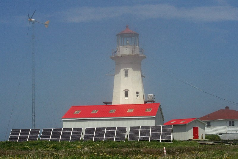 By late morning, the fog had burned off, giving a nice view of the lighthouse.  I talked a little to one of the keepers.