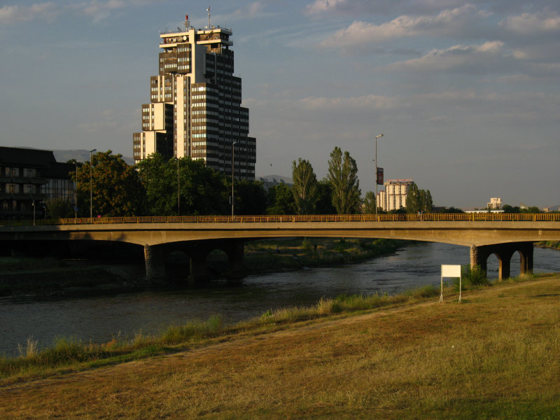 Modern bridge over the Vardar with tower block