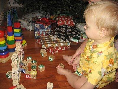 Simon plays with blocks