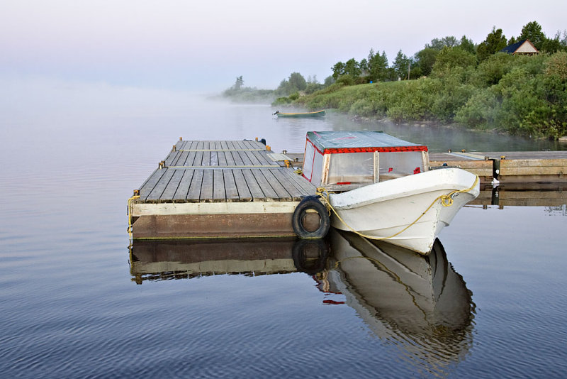 Taxi boat docked on a foggy morning.