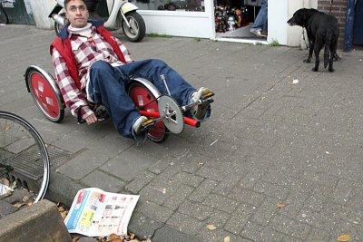 Three bikes, a dog, a paper and a macho man <br>061108-042b.jpg