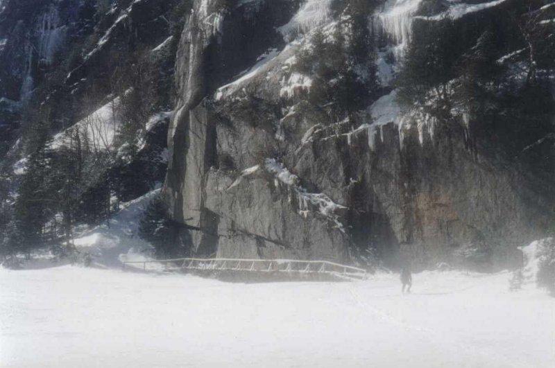 Bridge beside lake that is frozen