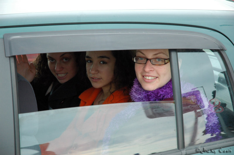 Three little girls sitting in the back seat...........