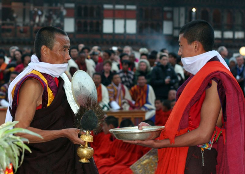 Two Monks performing the ritual ablutions