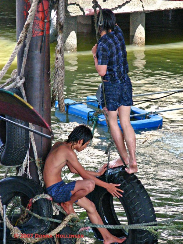 Kids playing in the Chao Praya River
