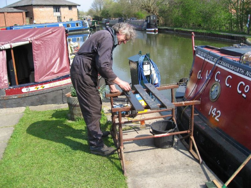 Graham dilling the last of the ballast still to be painted