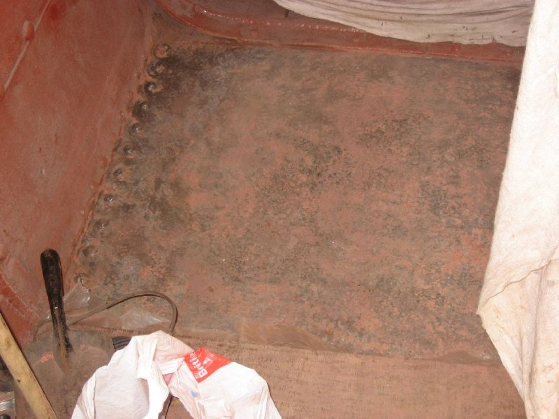 One of the floor sections having been angle ground