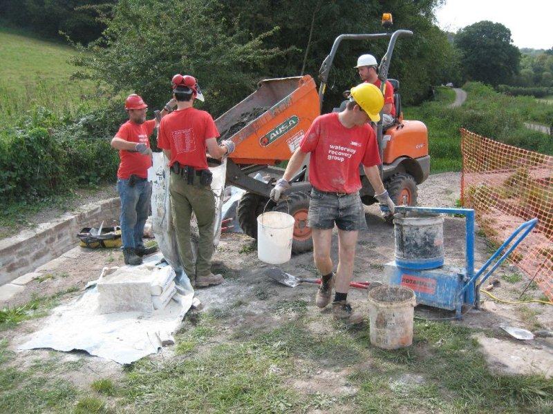 Fetching sand & mixing mortar