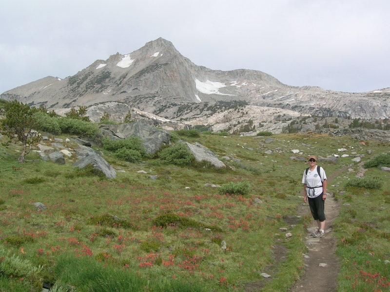 Cathy setting out from Saddleback Lake with Mount Conness in the background