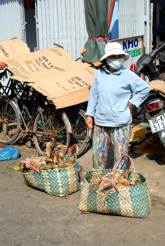 Duck vendor at market