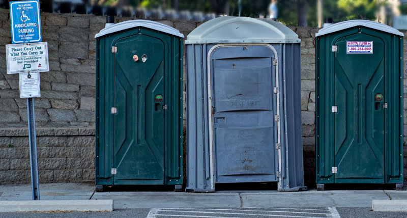 The middle sign on the left of these portable toilets makes me laugh.
