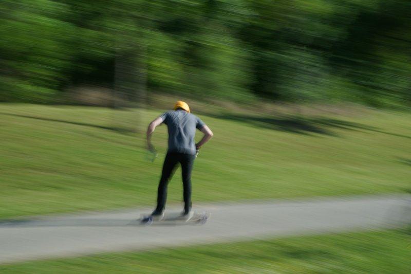 Skateboarder next to the bayou